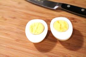 hard boiled eggs with knife